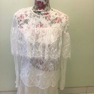 Long sleeved white lacy blouse